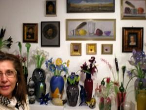 Linda viewing paintings by Denis Delomba