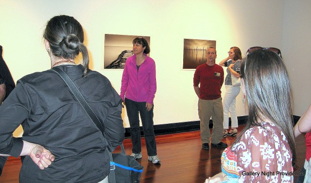 Gallery director Sara Young discusses the graduate show with Gallery Night Providence visitors